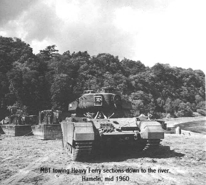 centurion-tank-towing-heavy-ferry-units-around-the-assembly-site-by-the-river-weser-ohr-park-summer-1960
