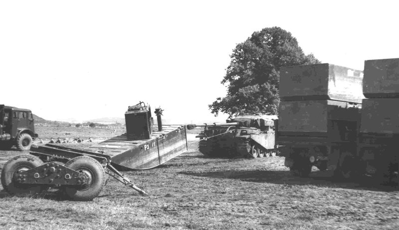 centurion-tank-towing-heavy-ferry-units-around-the-assembly-site-ohr-park-by-the-river-weser-summer-1960